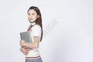 拿着笔记本电脑的女学生500908042图片