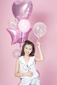 拿着气球的青年女性图片