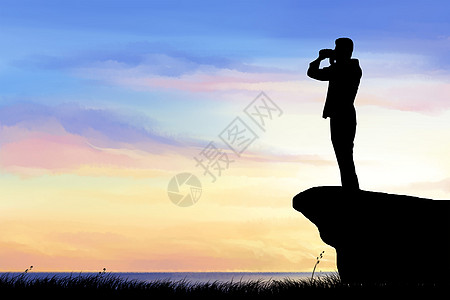 山顶上的人物剪影图片