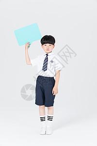 拿着对话框KT板做思考动作的儿童图片