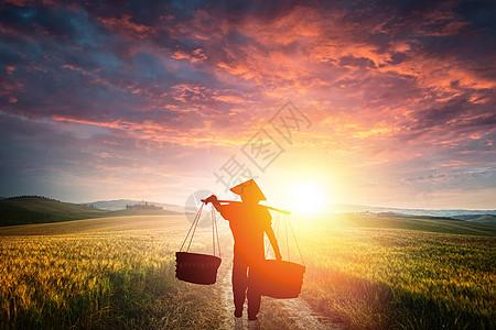田野间的农民图片