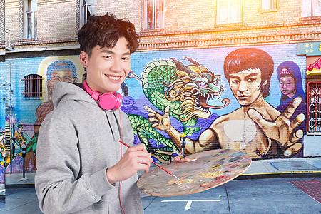 青年手绘彩色墙绘图片