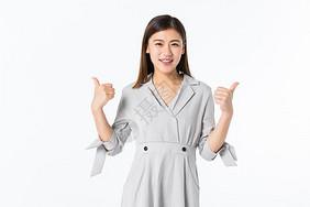 年轻商务女性举大拇指图片