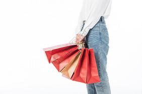 618女青年手拿购物袋特写图片