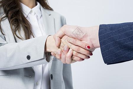商务男女握手图片