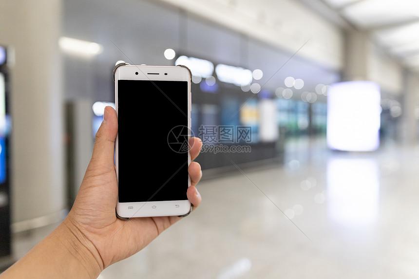 智能生活机场手持手机图片