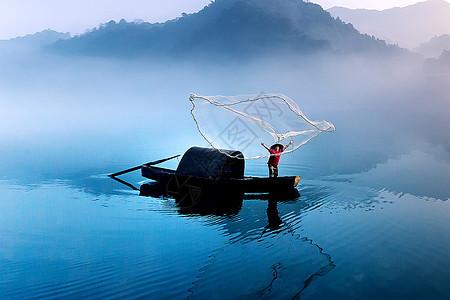 撒网捕鱼图片