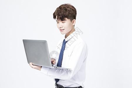 商务男士笔记本电脑图片