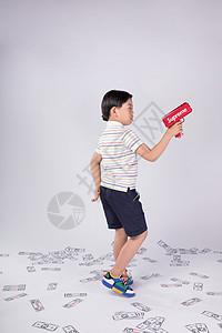 儿童玩喷钱枪图片