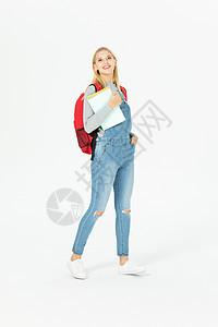 国外留学生背书包拿笔记本图片