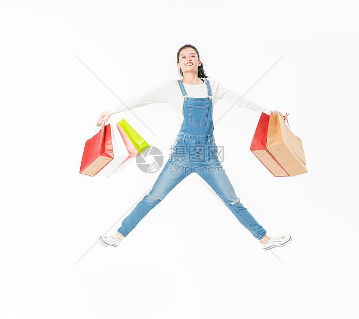 青春大学生购物跳跃图片