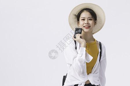 拿相机的可爱女性图片