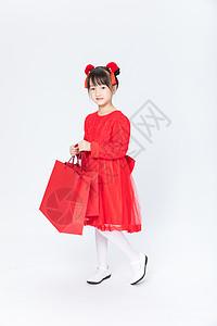 提购物袋的小女孩图片
