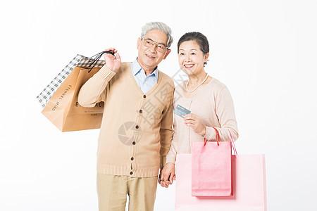 幸福的老年夫妻消费购物图片