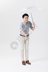 爸爸撑伞迎接孩子动作手势图片