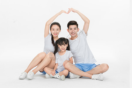 坐在地上的幸福一家人图片