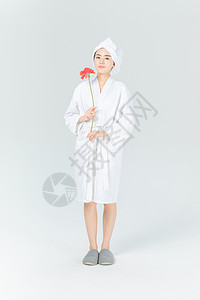 穿浴袍的美女与花图片