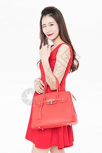 手提包包的美女图片