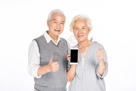 老年人手拿手机图片