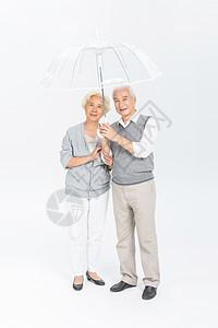 老年夫妻打伞图片