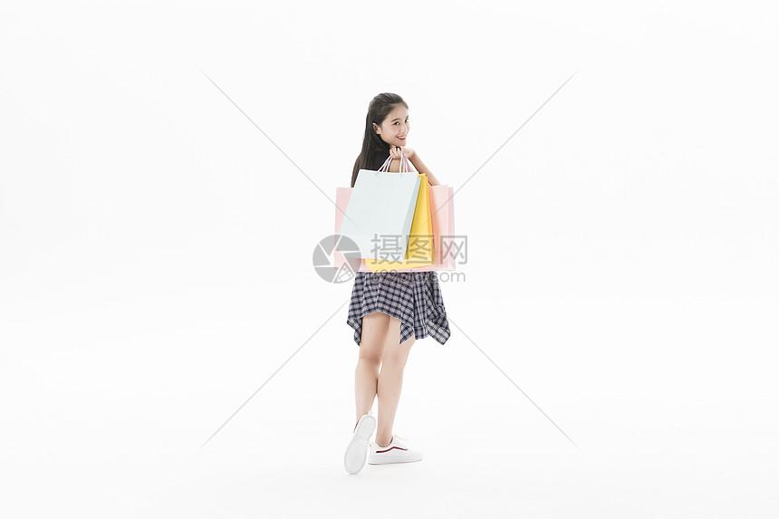 女性购物背影图片