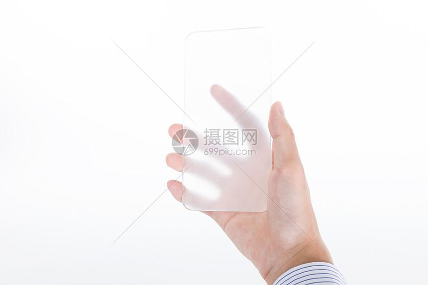 手拿透明手机图片