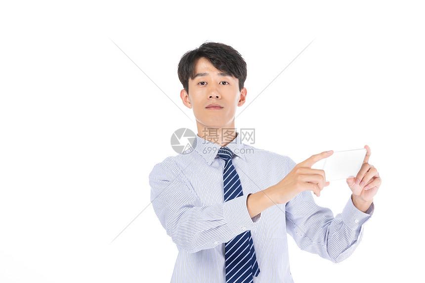 商务男士使用手机图片