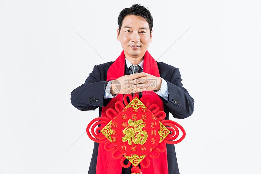 新春商务男性手拿福字拜年图片