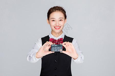 拿信用卡的客服职员图片