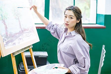 青春女孩坐着画油画图片