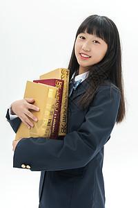 女学生抱着书本图片