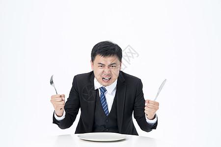 等待上菜的商务男士愤怒图片
