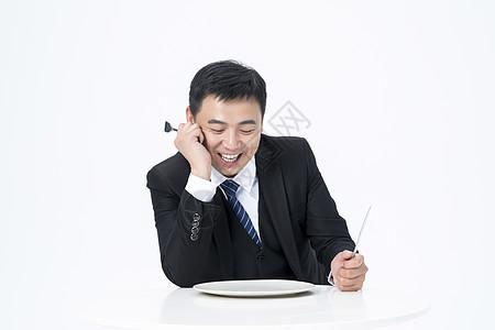 等待上菜的商务男士图片