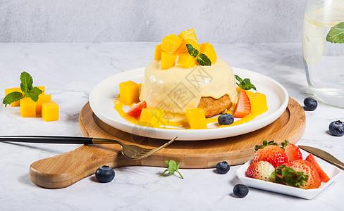 芒果舒芙蕾甜品图片