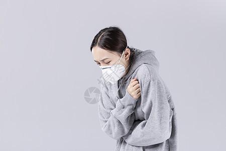 带着口罩咳嗽的女孩图片