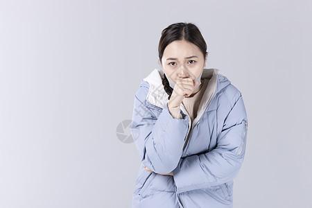 戴着口罩咳嗽的女孩图片