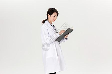 女性医生拿病历图片
