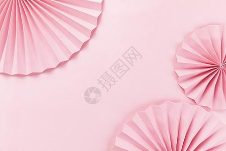 粉色背景上的纸伞图片