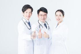 年轻的医生们举大拇指图片