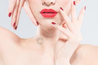 女性美妆红唇美甲图片