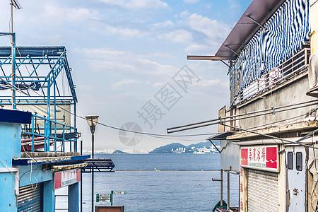 香港长洲岛清新海边小楼背景图片