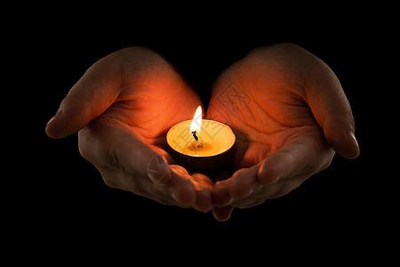 手捧蜡烛祈福图片