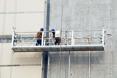 高墙建筑工人图片