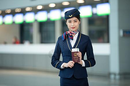 空姐手拿护照机票图片