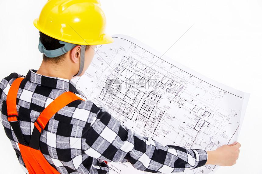 建筑设计师看图纸图片