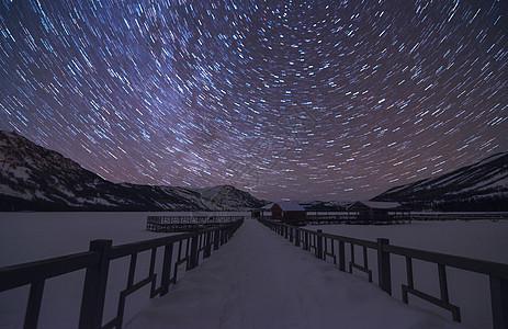 星空星轨夜雪风景图片