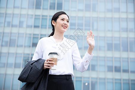 商务女性打招呼图片