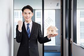 房地产销售手拖房子模型图片