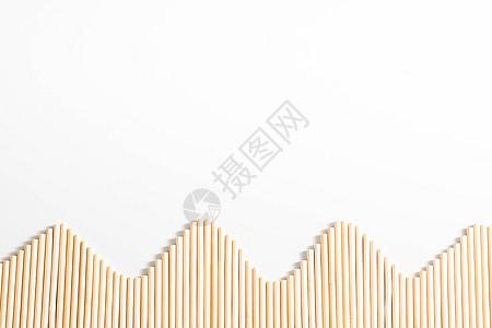 小木棍摆成的波浪弧形图片