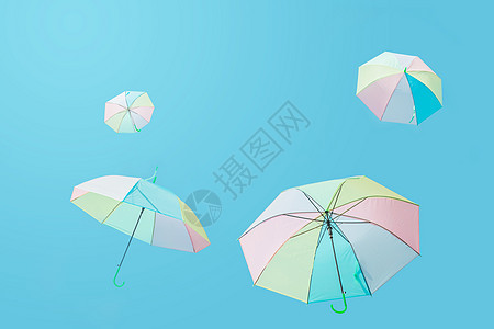 飞上蓝天的彩色伞图片